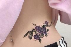 Татуировка : Змея, Цветы на животе